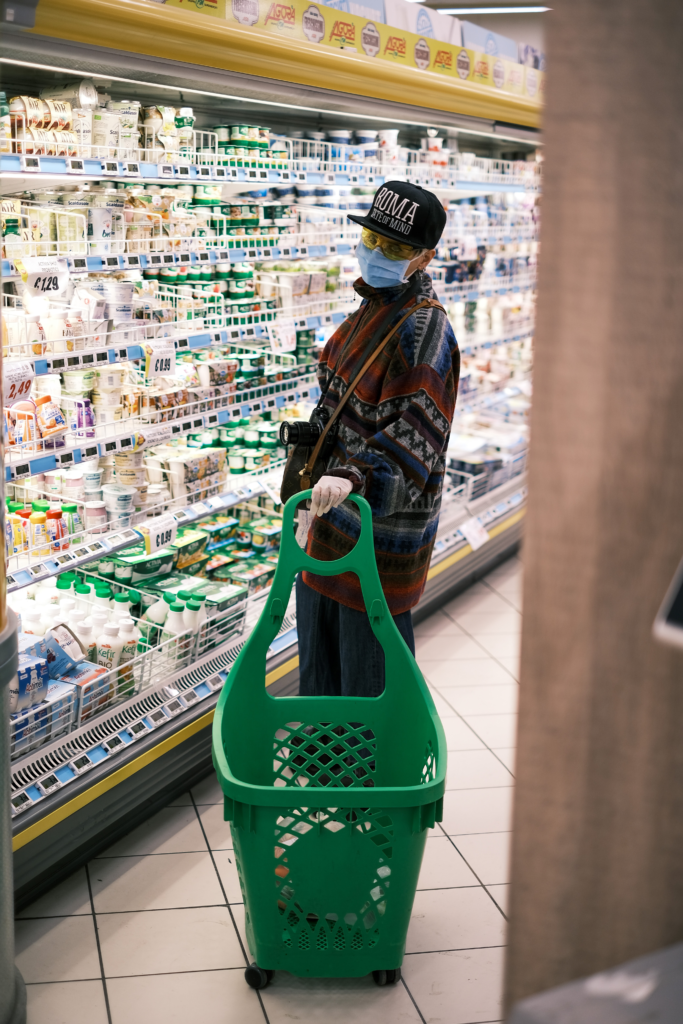 Image of grocery shopper wearing a face mask. Photo by Giuseppe Argenziano on Unsplash