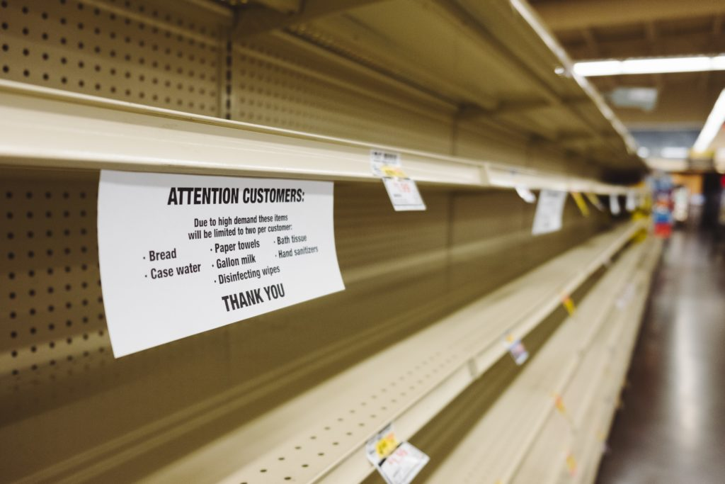 Image of empty grocery retailer shelves after supply chain issues and high demand caused out-of-stocks for some products